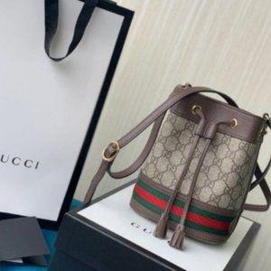 GUCCI Ophidia GG mini monogrammed bucket bag